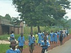 School children walk home.