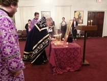 Wednesday Evening Adding wine to oil for Holy Unction.