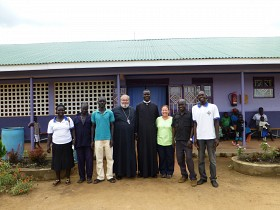 Fr. George, Fr. Joseph & Nurse Sue with staff