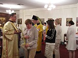 Parishioners receive the blessed branches.